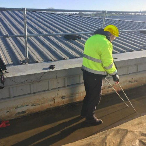 person examinating roof cooneys